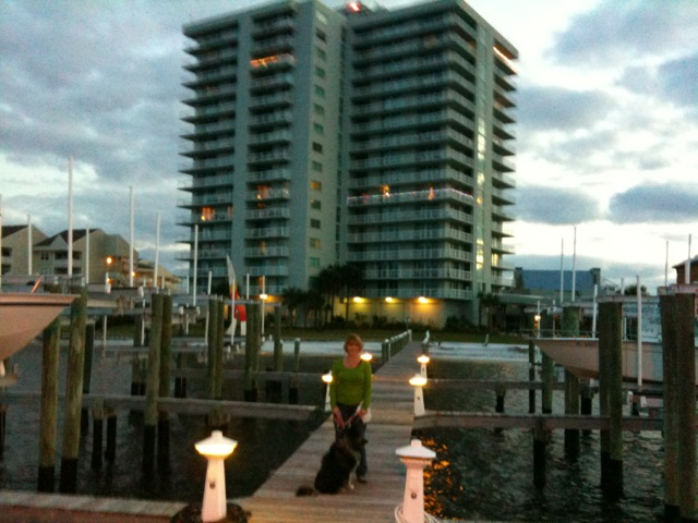 Tristan Towers Unit 12a View From Boat Dock At Dusk Is On The Right Side With Wrap Around Balcony